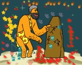Hombre prehistórico con pinturas rupestres
