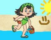 Niña con cubo y pala de playa