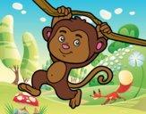 Mono colgado de una rama